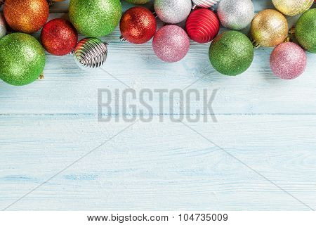 Christmas wooden background with colorful baubles