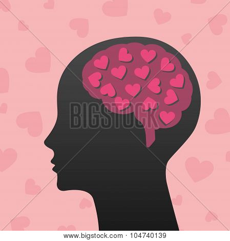 Silhouette of human head with pink hearts
