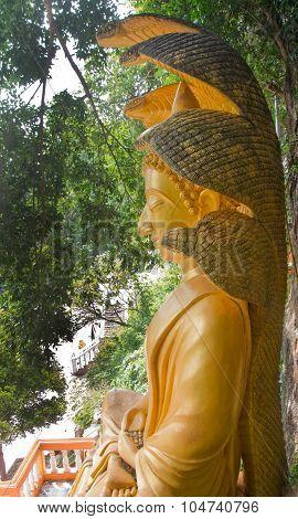 Big Buddha With A Naga Over His Head In Thai Temple