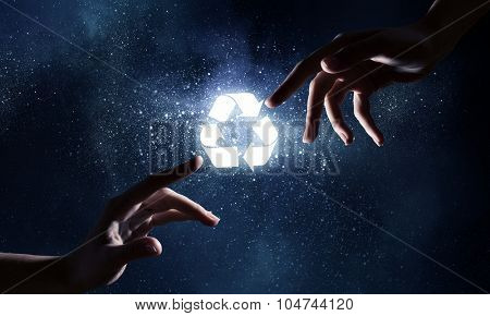 Close up of human hands touching with fingers and recycle symbol