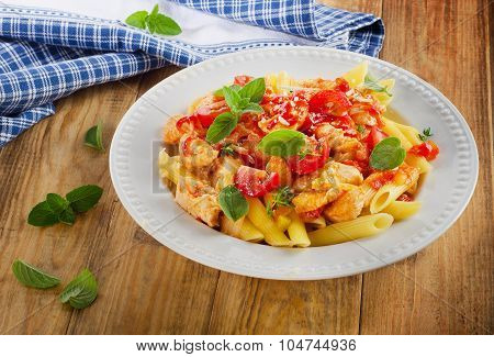 Pasta Penne With Chicken, Sauce And Vegetables.