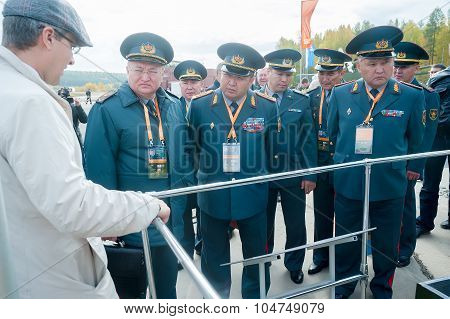 Officers of Kazakh army examine troop-carrier