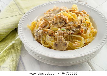 Plate Of Pasta With Mushrooms And Cream Sauce.
