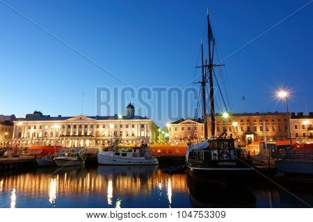 Fishing boats and a sailing ship at the Helsinki Market Square on October evening