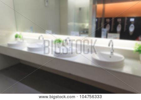 Abstract blur men toilet