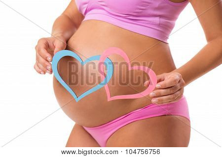 Close-up Of A Pregnant Belly With Pink And Blue Hearts. Guess The Sex Of The Baby-child: Girl, Boy O
