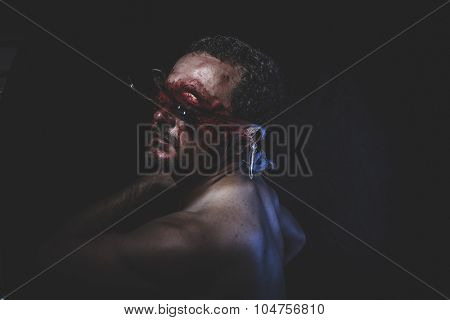 Nightmare, naked man with blindfold soaked in blood