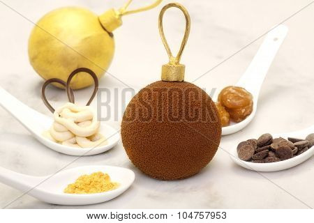 Christmas Chocolate Bauble With Some Ingredients Which Is Made Of