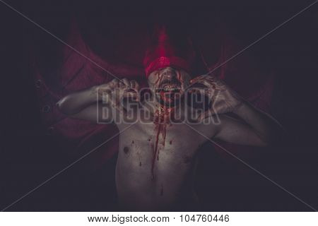 Nightmare, naked man on large red cloth over his eyes