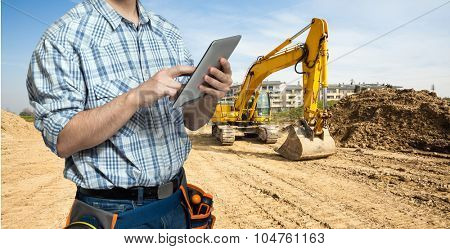 Worker using a tablet in a construction site