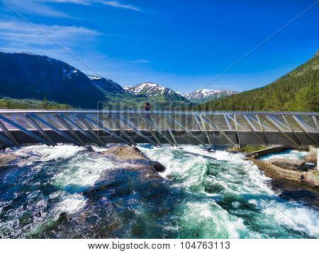 Girl On Bridge Above Waterfall