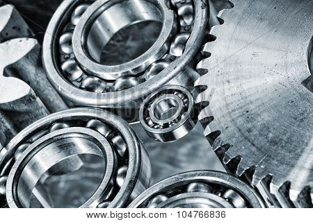 ball-bearings and cogwheels in a machinery concept