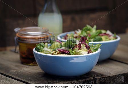 Two Bowls Of Mixed Salad