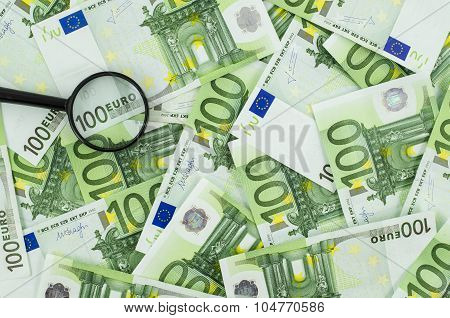 Magnifying glass on euro banknotes background