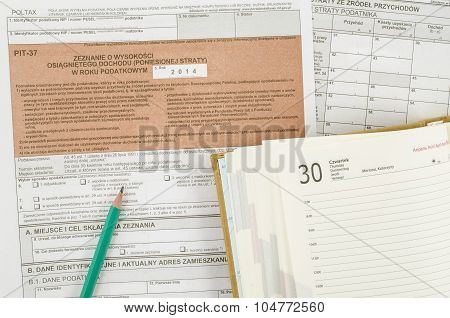 Polish tax form with pencil and calendar