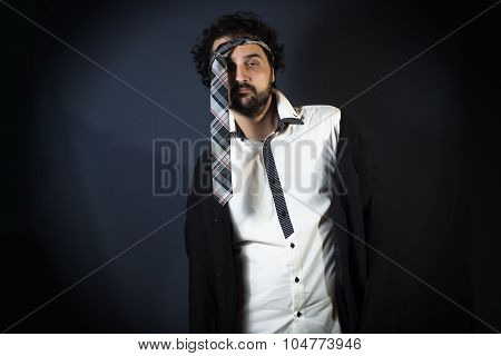 Young Man Drunk With Necktie On Head