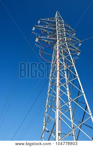 Power line with clear blue sky.