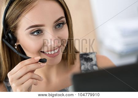 Portrait Of Beautiful Call Center Operator At Work