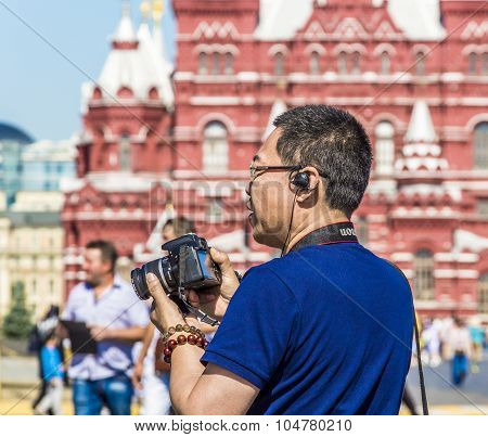 Tourist-photographer On The Red Square
