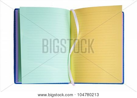 open varicolored notebook lies on surface, horizontal