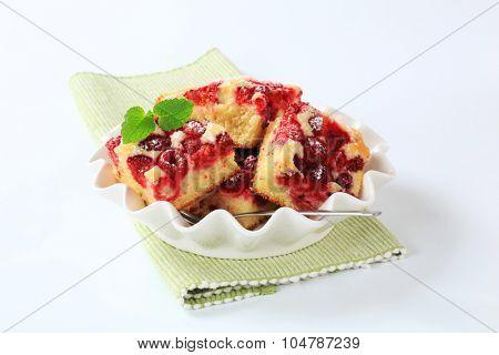 raspberry sponge cake  slices in decorative dish