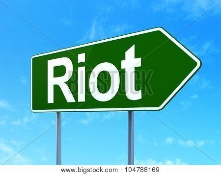 Political concept: Riot on road sign background