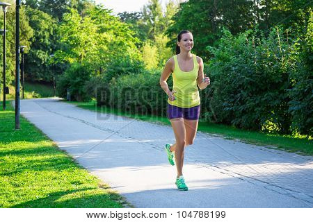 Happy Jogging Woman Running In Park