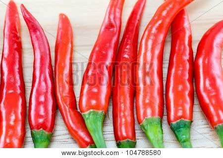 Red Chillis on wooden top