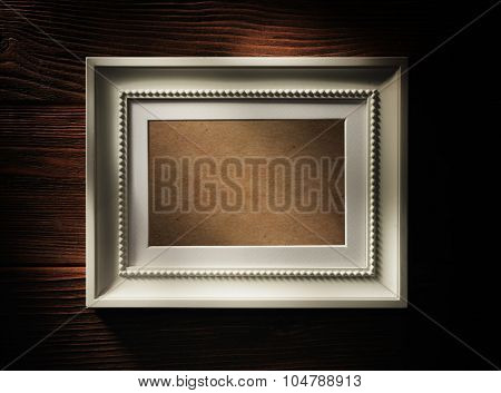 Empty wooden frame on wood background