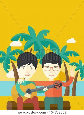 Two happy asian men  sitting on a log playing a guitar at the beach under palm trees vector flat design illustration. Vertical layout with a text space.