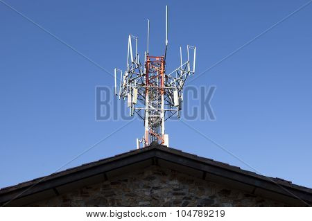 Mobile Phone Telecommunication Tower On The Rrof