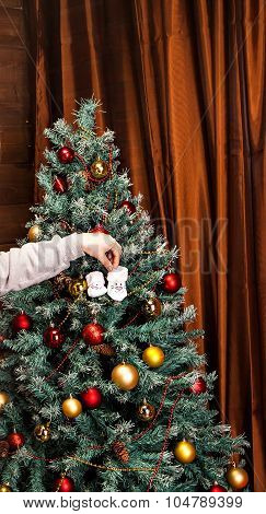 Baby booties on the background of Christmas tree