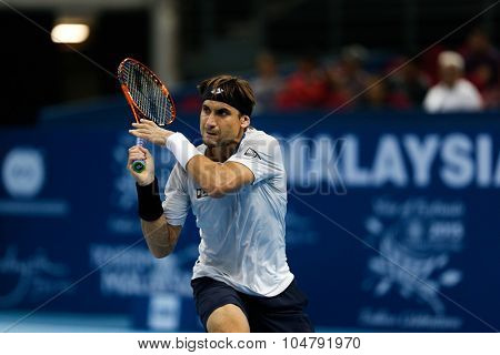 KUALA LUMPUR, MALAYSIA - OCTOBER 02, 2015: Spain's David Ferrer hits a backhand return in his match at the Malaysian Open 2015 tennis tournament held at the Putra Stadium, Malaysia.