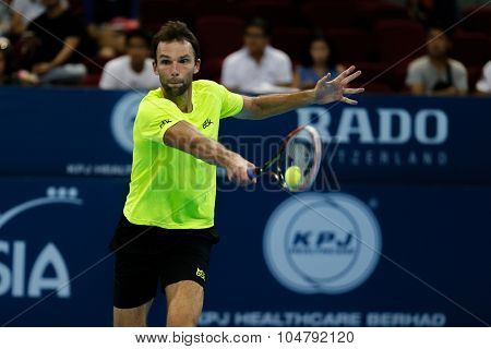 KUALA LUMPUR, MALAYSIA - OCTOBER 02, 2015: Croatia's Ivo Karlovic plays a backhand return in his match at the Malaysian Open 2015 tennis tournament held at the Putra Stadium, Malaysia.