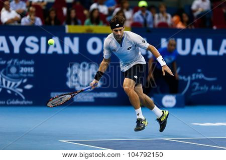 KUALA LUMPUR, MALAYSIA - OCTOBER 02, 2015: Spain's David Ferrer prepares to play a forehand return in his match at the Malaysian Open 2015 tennis tournament held at the Putra Stadium, Malaysia.