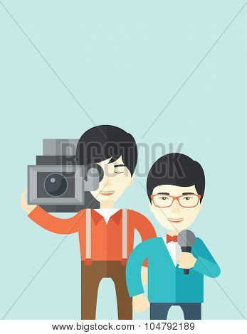 An Asian cameraman filming a reporter vector flat design illustration isolated on blue background. Vertical layout.