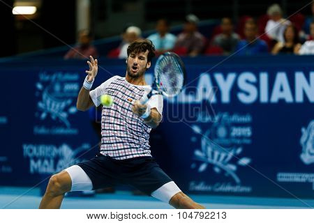 KUALA LUMPUR, MALAYSIA - OCTOBER 02, 2015: Spain's Feliciano Lopez plays a forehand return in his match at the Malaysian Open 2015 tennis tournament held at the Putra Stadium, Malaysia.