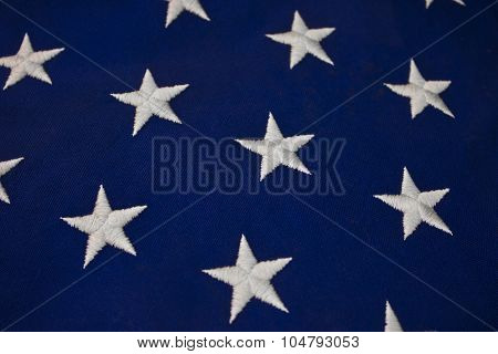 Closeup of White Stars on Blue Background of American Flag or Navy Jack for Background or Abstract