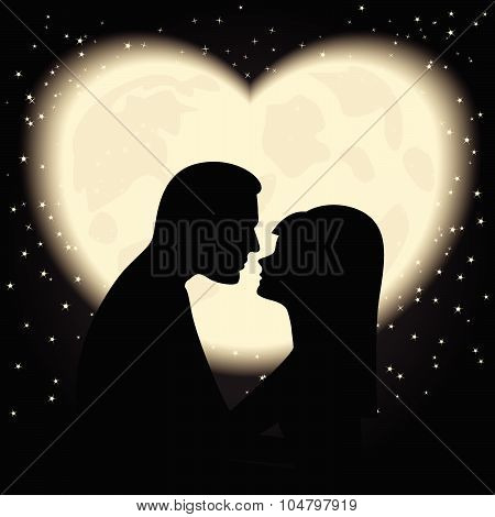 Silhouette of lovers on a background of the moon like the heart
