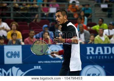 KUALA LUMPUR, MALAYSIA - OCTOBER 03, 2015: Australia's tennis player Nick Kyrgios checks with the chair umpire over a call at the 2015 Malaysian Open tennis tournament in Stadium Putra.