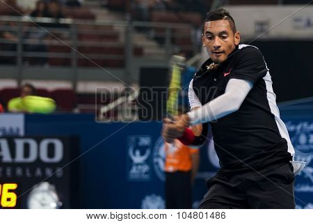 KUALA LUMPUR, MALAYSIA - OCTOBER 03, 2015: Australia's tennis player Nick Kyrgios plays a backhand return at the 2015 Malaysian Open tennis tournament from Sep 26 - Oct 4, 2015 in Stadium Putra.