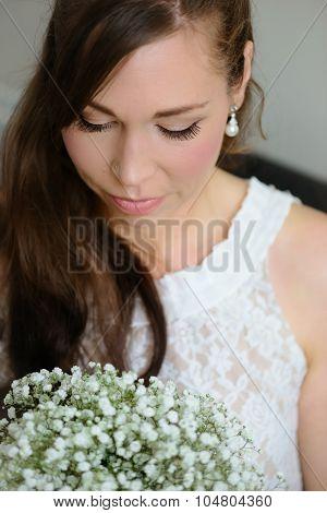Bridal portrait of a white caucasian female looking down retro vintage lace dress
