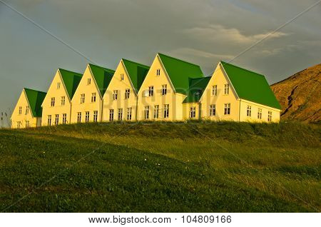 Houses near Laugarvatn lake at sunrise, south Iceland