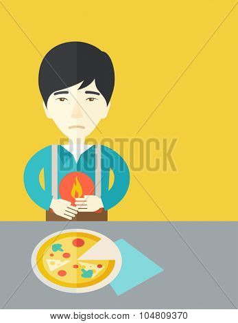 A sick asian man with heartburn due to pizza holding hands on his stomach vector flat design illustration. Vertical poster layout with a text space.