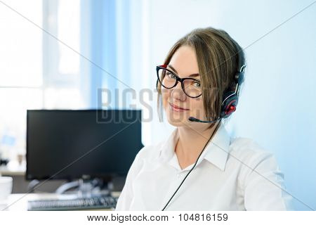 Young Attractive Smiling Customer Support Phone Operator with Headset in the Office.