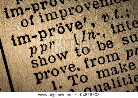 Close-up Of The Word Improve And Its Definition