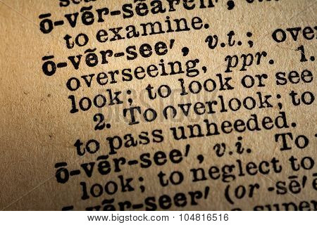Close-up Of The Word Oversee And Its Definition