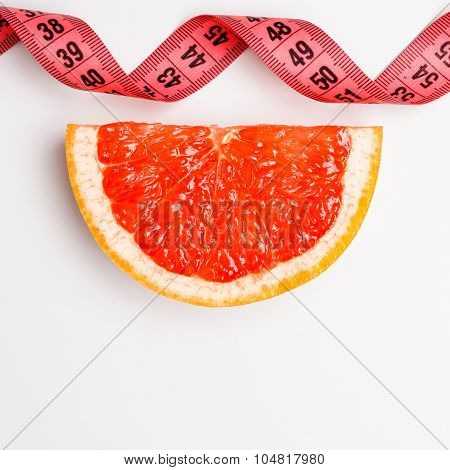 Measuring Tape And Grapefruit Slice