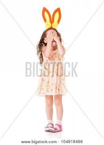 Happy little girl with bunny ears over white background