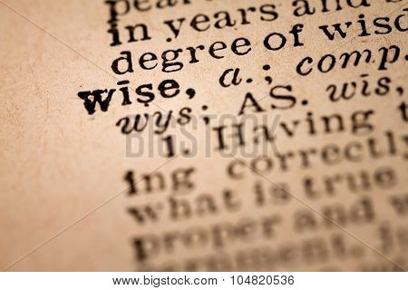 Close-up Of An Opened Dictionary Showing The Word Wise